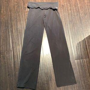 Small ruffle top Pink straight leg yoga pants.